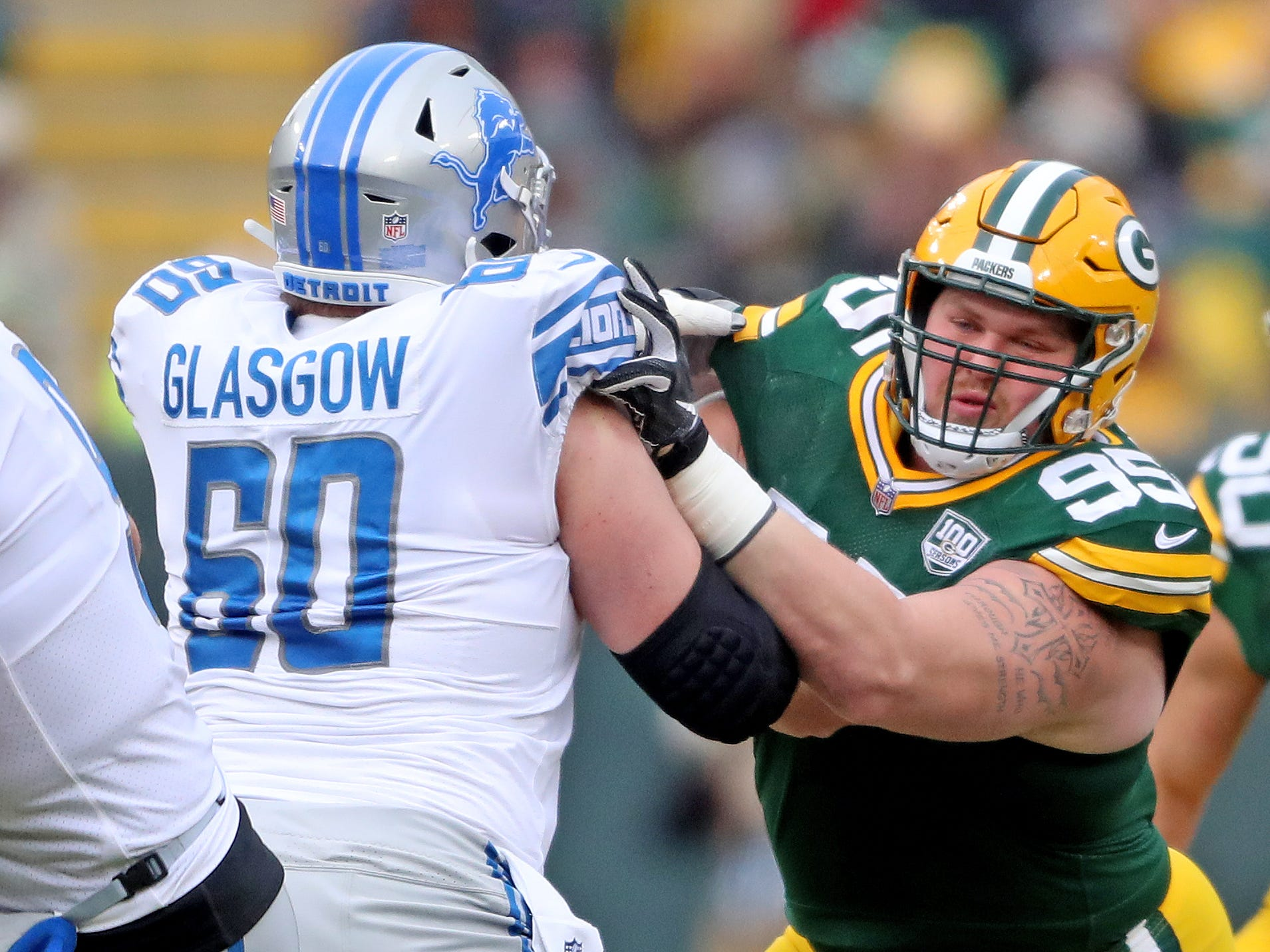 Green Bay Packers defensive tackle Tyler Lancaster (95) blocks against the Detroit Lions center Graham Glasgow (60) at Lambeau Field Sunday, December 30, 2018 in Green Bay, Wis.