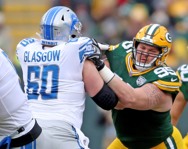 Green Bay Packers defensive tackle Tyler Lancaster (95) blocks against the Detroit Lions center Graham Glasgow (60) at Lambeau Field on Sunday, Dec. 30, 2018, in Green Bay, Wis.