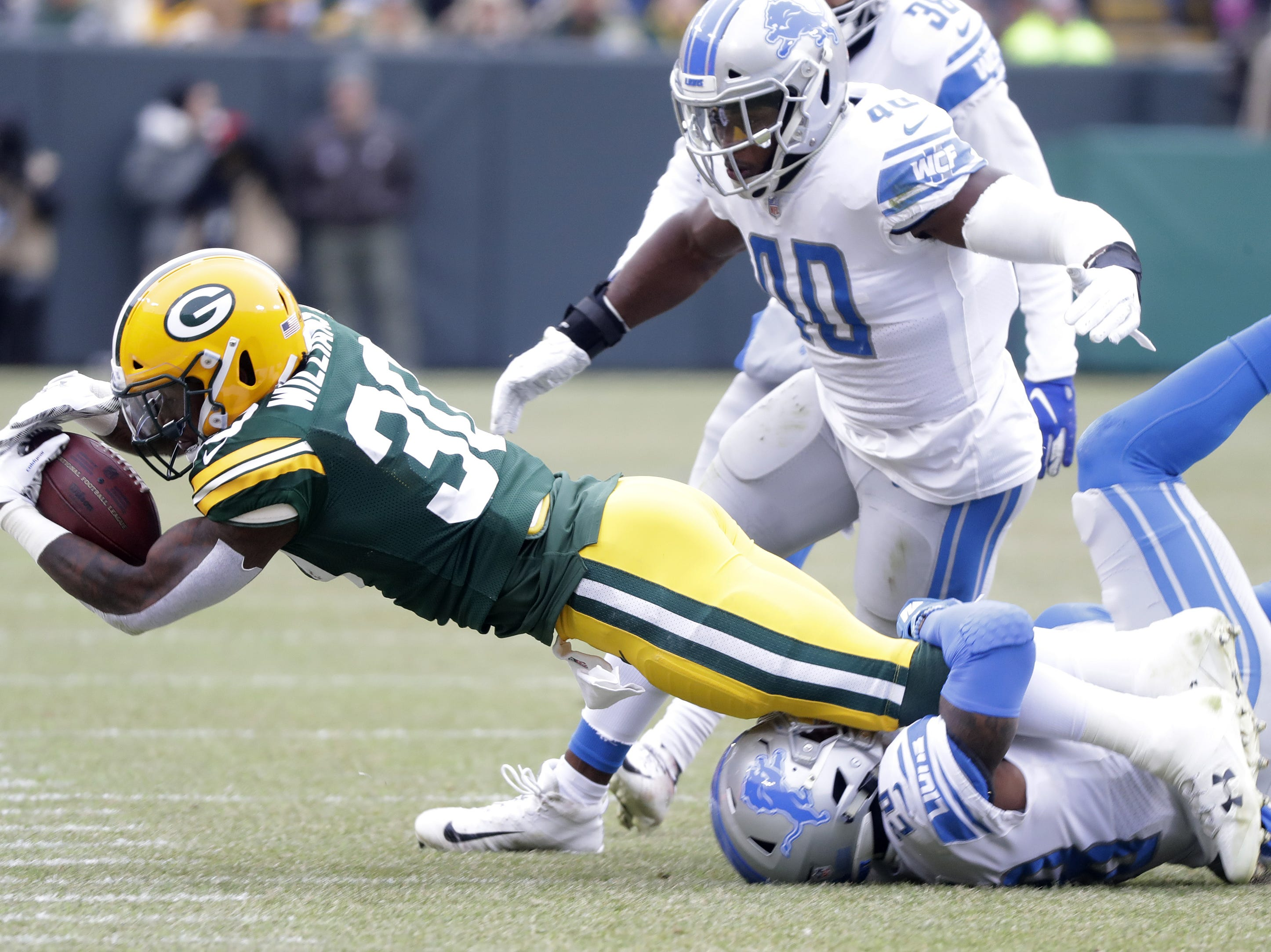 Green Bay Packers running back Jamaal Williams (30) stretches for extra yards in the first quarter against the Detroit Lions at Lambeau Field on Sunday, December 30, 2018 in Green Bay, Wis. Adam Wesley/USA TODAY NETWORK-Wis