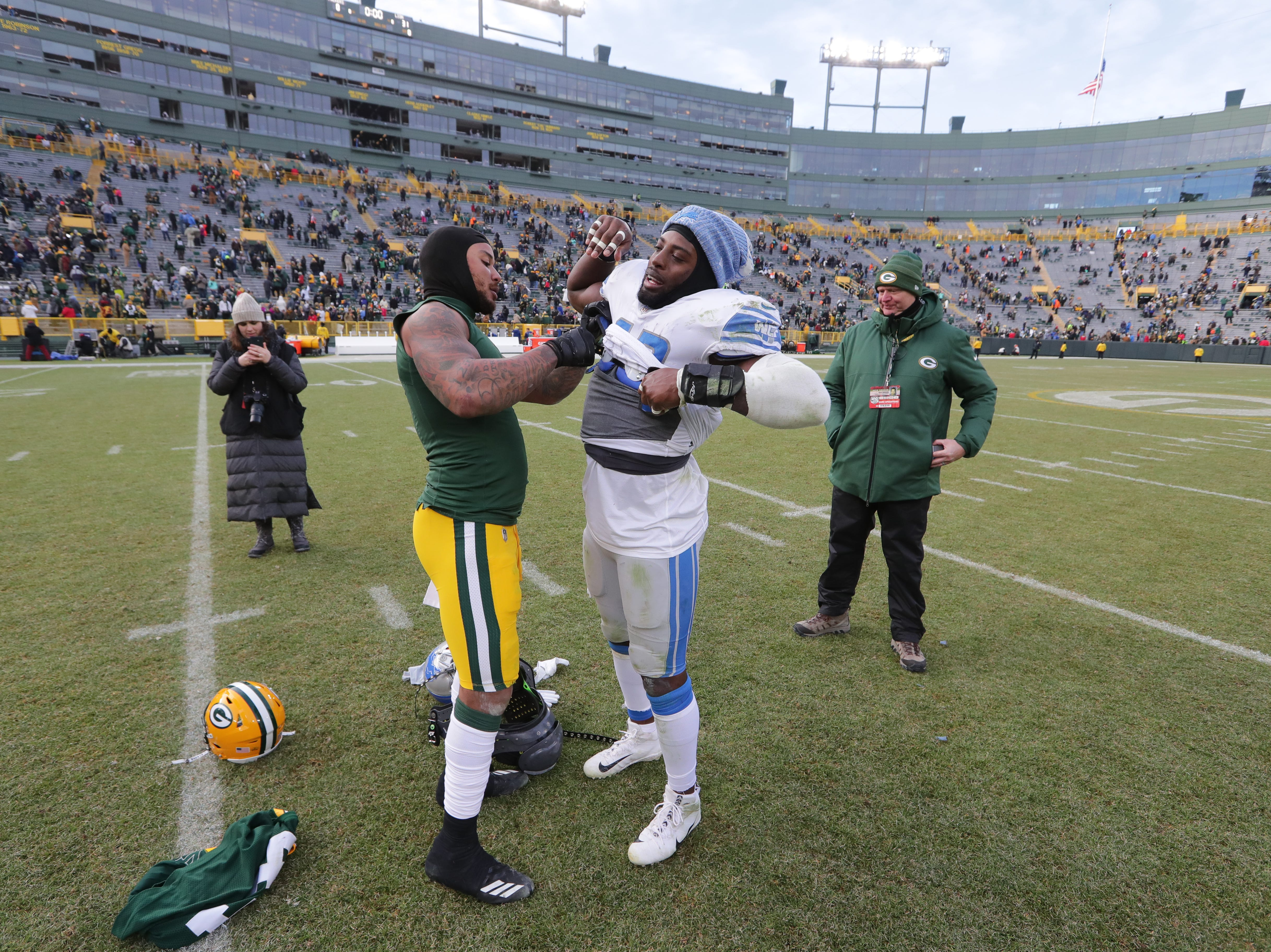 Green Bay Packers inside linebacker Antonio Morrison (left) helps Detroit Lions middle linebacker Jarrad Davis (40) remove his jerseys so they can trade after their game Sunday, December 30, 2018 at Lambeau Field in Green Bay, Wis. The Detroit Lions beat the Green Bay Packers 31-0.  MARK HOFFMAN/MILWAUKEE JOURNAL SENTINEL