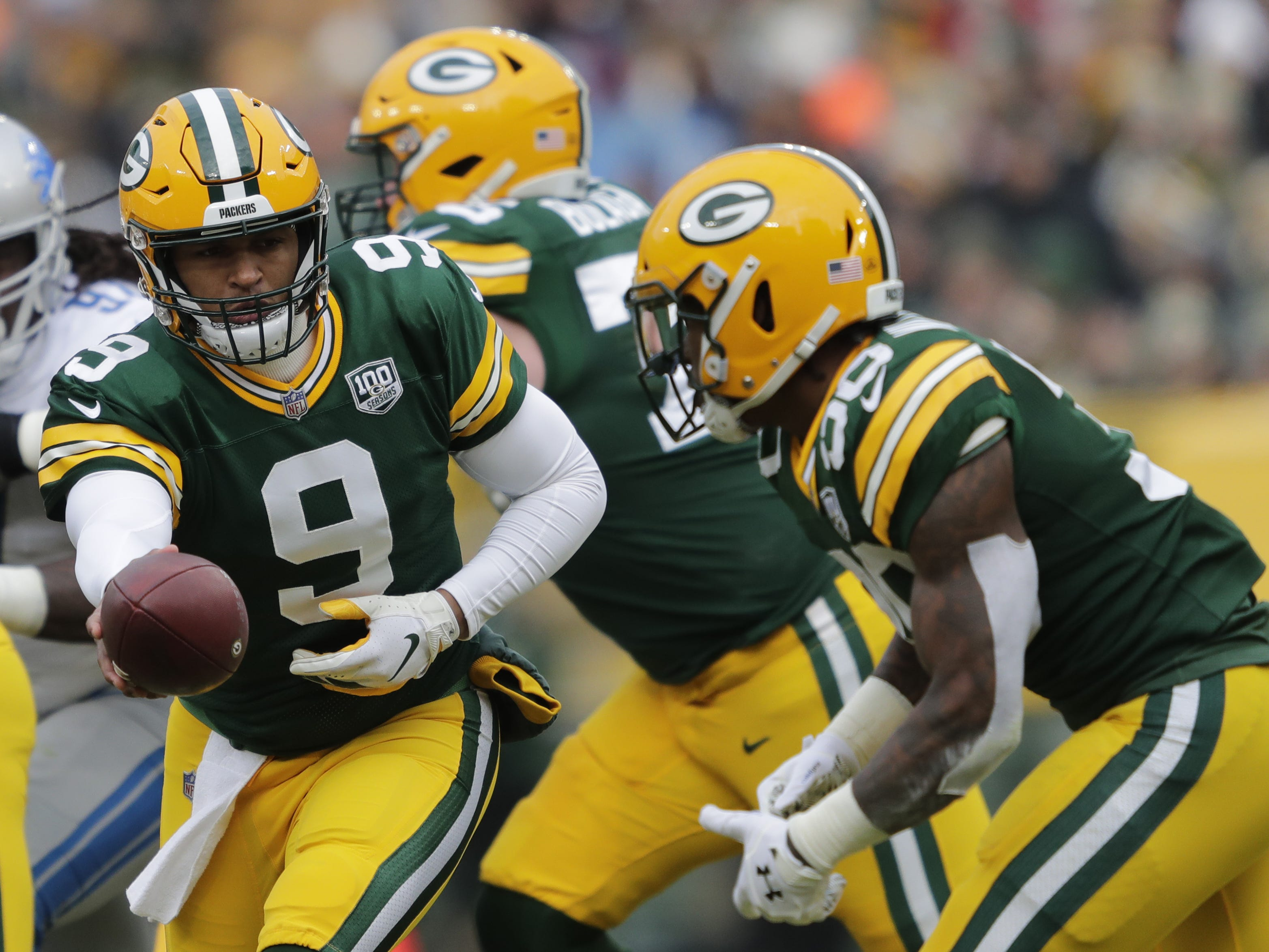 Green Bay Packers quarterback DeShone Kizer (9) hands off the ball to running back Jamaal Williams (30) against the Lions Sunday, December 30, 2018, at Lambeau Field in Green Bay, Wis.  Dan Powers/USA TODAY NETWORK-Wisconsin