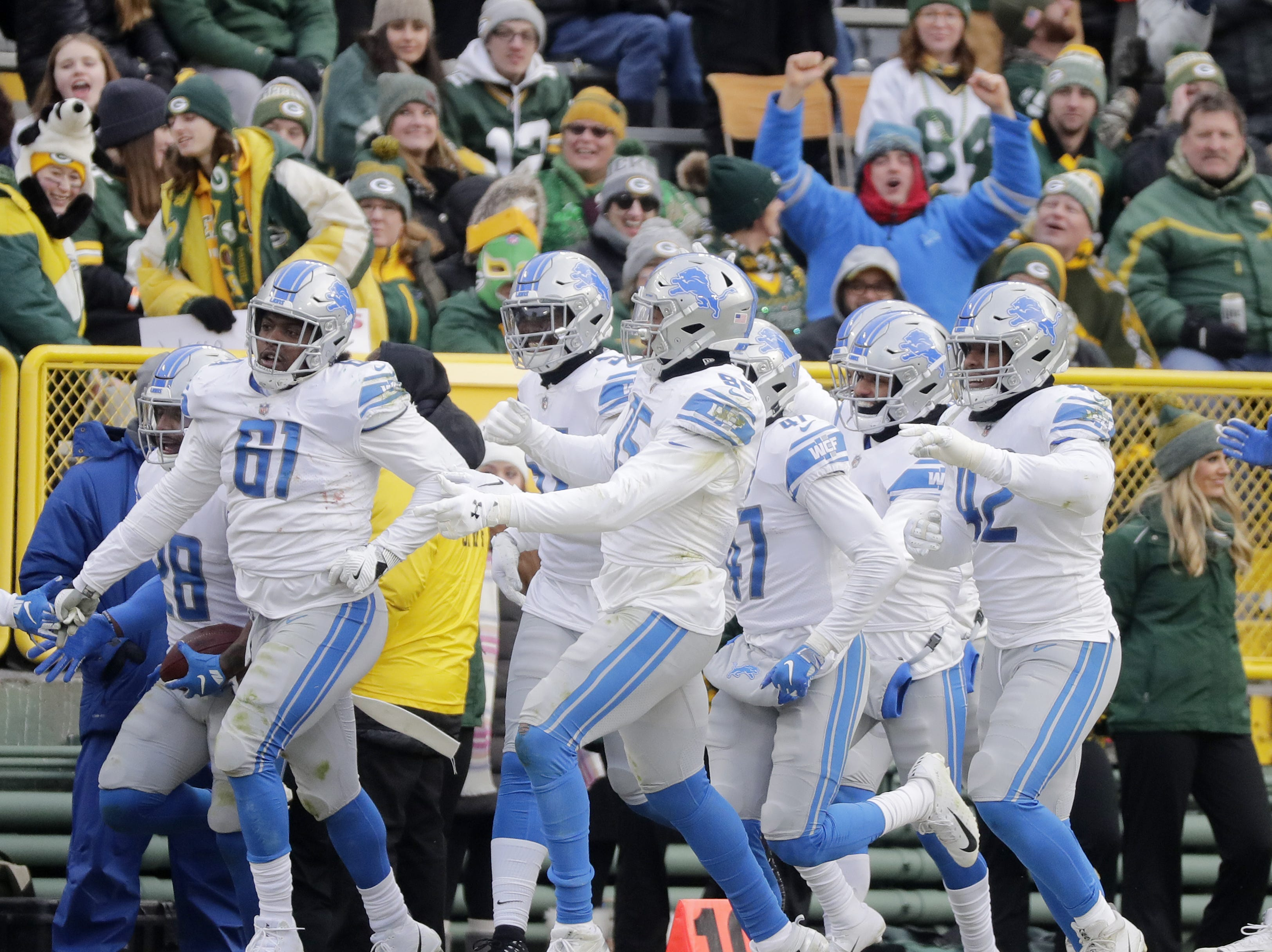 Detroit Lions players celebrate after an interception by Detroit Lions strong safety Quandre Diggs (28) in the fourth quarter at Lambeau Field on Sunday, December 30, 2018 in Green Bay, Wis. Adam Wesley/USA TODAY NETWORK-Wis