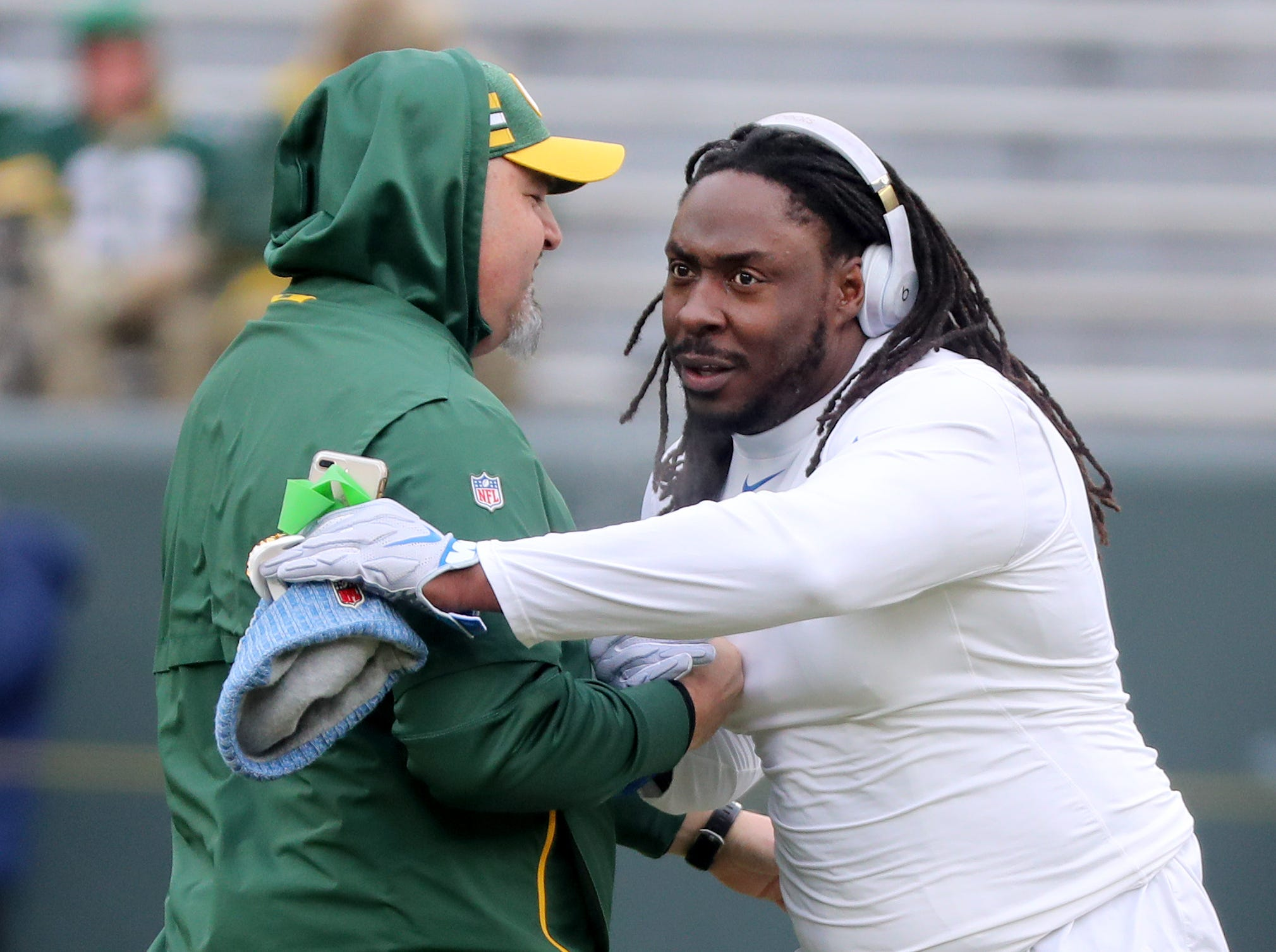 Former Packer Ricky Jean Francois greets a Packers staff member before the game against the Detroit Lions at Lambeau Field Sunday, December 30, 2018 in Green Bay, Wis.