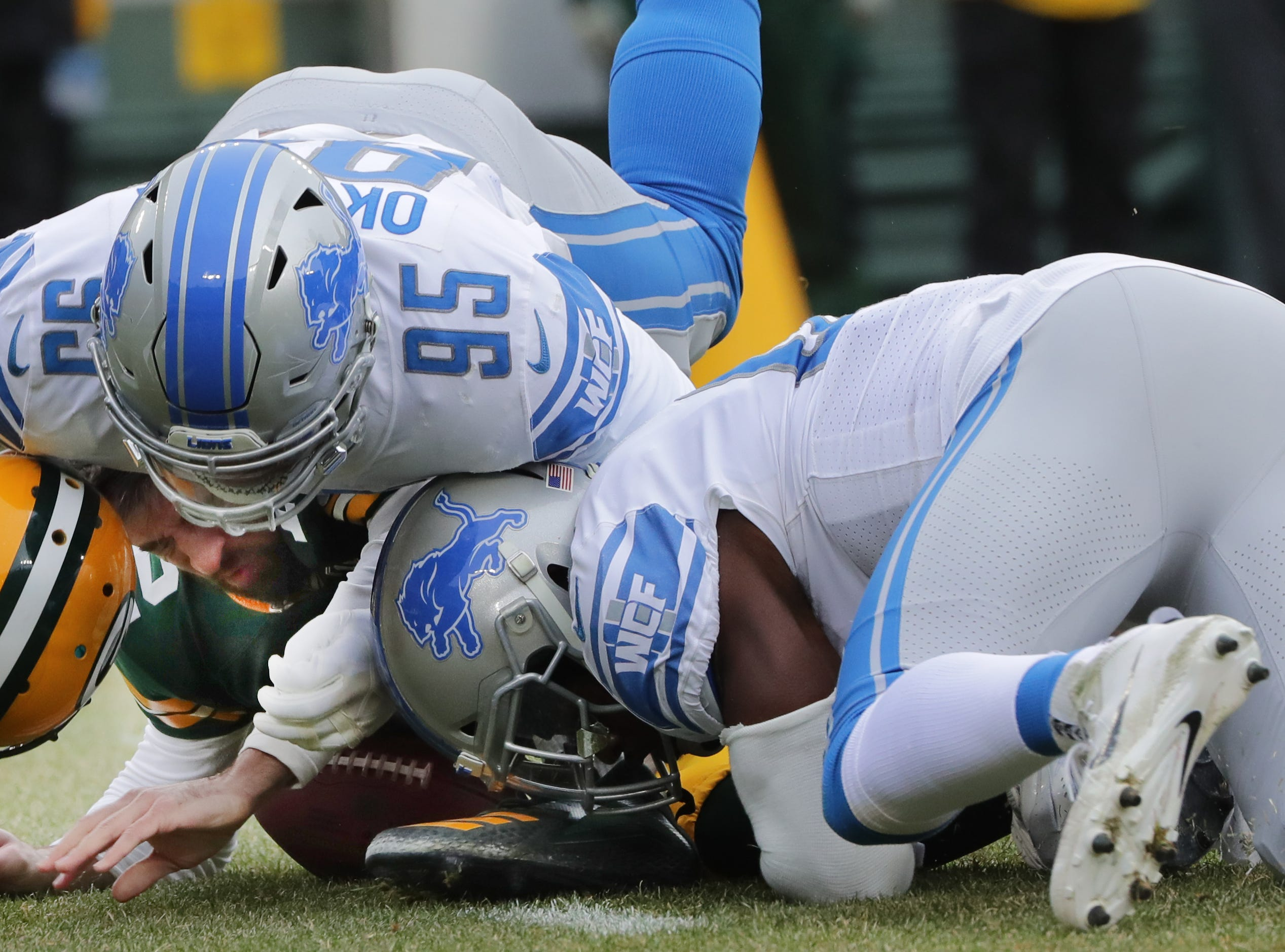 Green Bay Packers quarterback Aaron Rodgers (12) is sacked by Detroit Lions defensive end Romeo Okwara (95) during the first quarter of their game Sunday, December 30, 2018 at Lambeau Field in Green Bay, Wis.  MARK HOFFMAN/MILWAUKEE JOURNAL SENTINEL