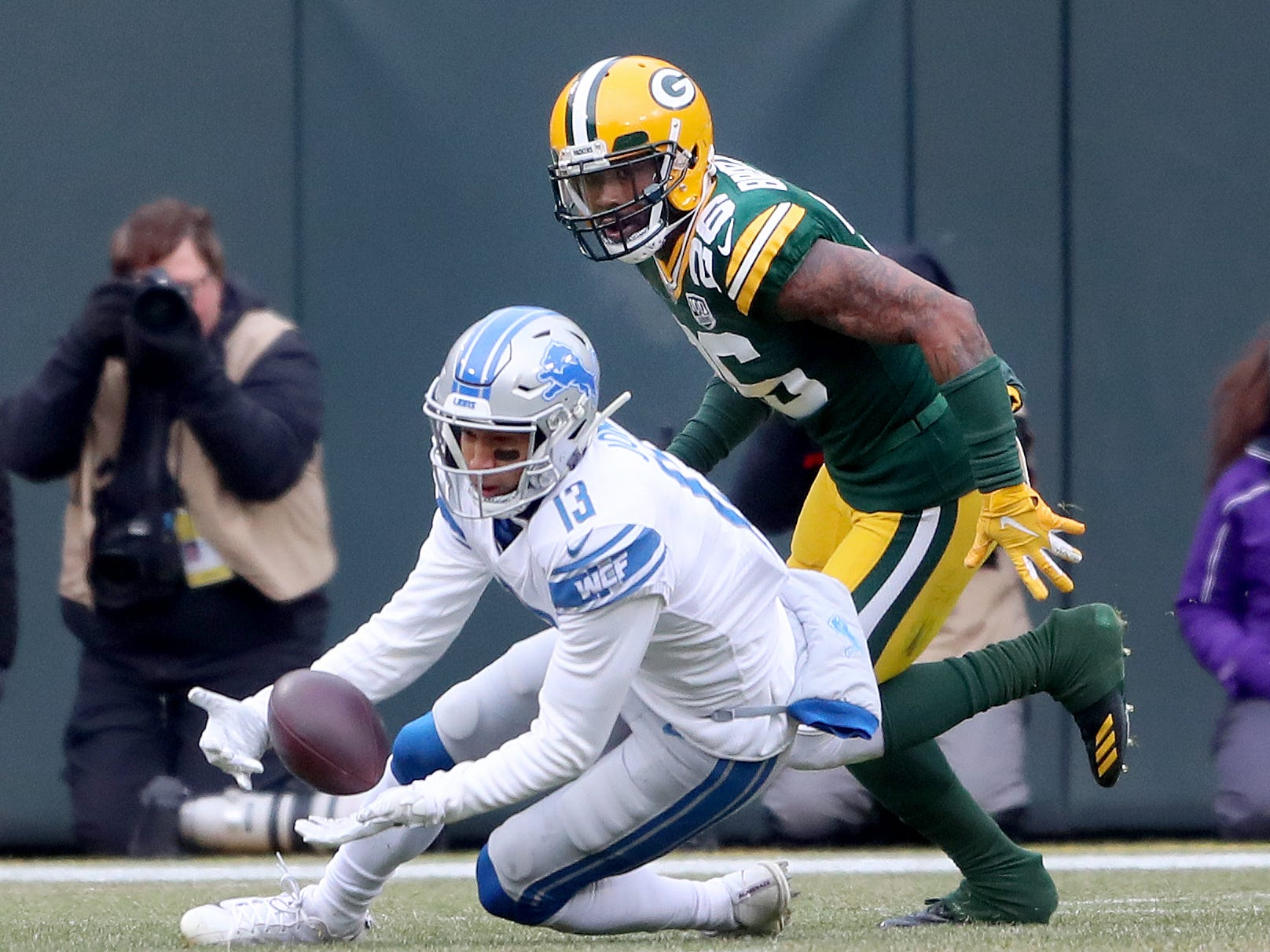 Detroit Lions wide receiver T.J. Jones (13) makes a catch against Green Bay Packers defensive back Raven Greene (36) at Lambeau Field Sunday, December 30, 2018 in Green Bay, Wis.