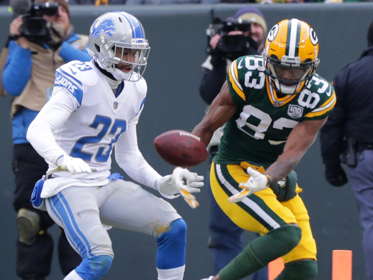 Green Bay Packers wide receiver Marquez Valdes-Scantling (83) is unable to grab a redemption while being covered by Detroit Lions cornerback Darius Slay (23) during the third quarter of their game Sunday, December 30, 2018 at Lambeau Field in Green Bay, Wis. The Detroit Lions beat the Green Bay Packers 31-0.  MARK HOFFMAN/MILWAUKEE JOURNAL SENTINEL
