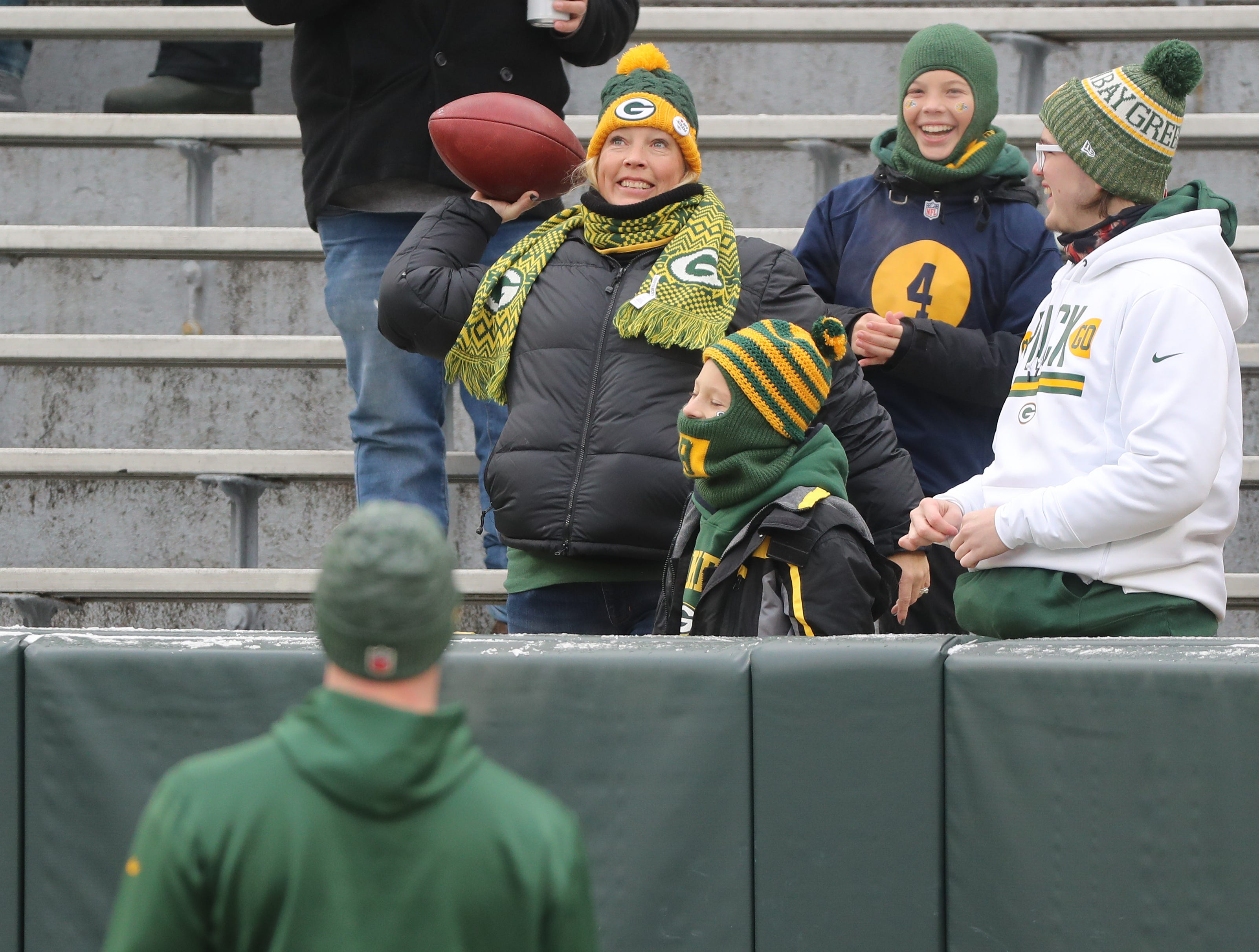 Fans play catch with Green Bay Packers quarterback Tim Boyle (8) before the game against the Detroit Lions at Lambeau Field Sunday, December 30, 2018 in Green Bay, Wis.