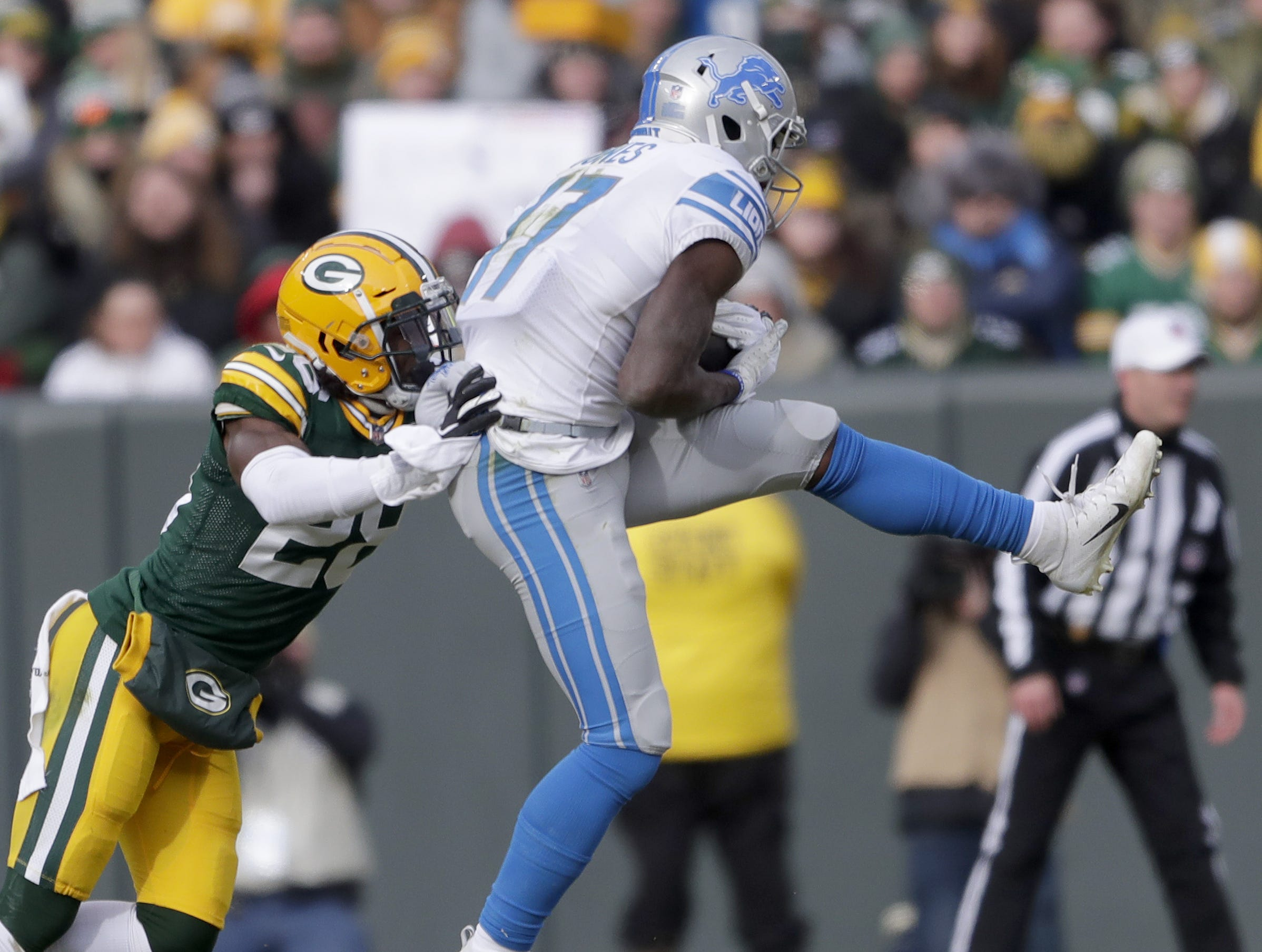 Detroit Lions wide receiver Andy Jones (17) makes a catch in front of Green Bay Packers strong safety Kentrell Brice (29) at Lambeau Field Sunday, December 30, 2018 in Green Bay, Wis.