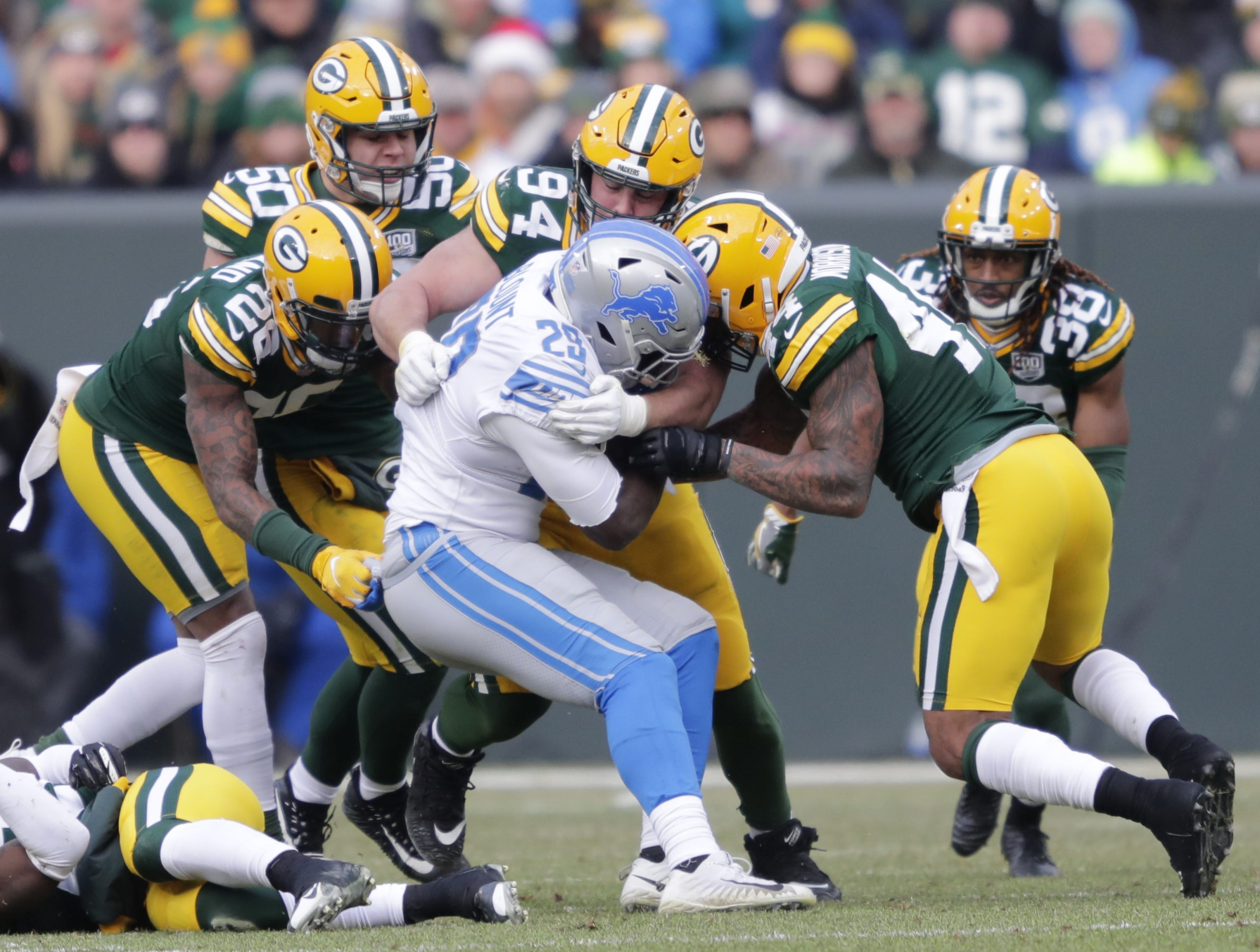 Detroit Lions running back LeGarrette Blount (29) is brought down by Packers defenders during the third quarter Sunday, December 30, 2018, at Lambeau Field in Green Bay, Wis.  Dan Powers/USA TODAY NETWORK-Wisconsin
