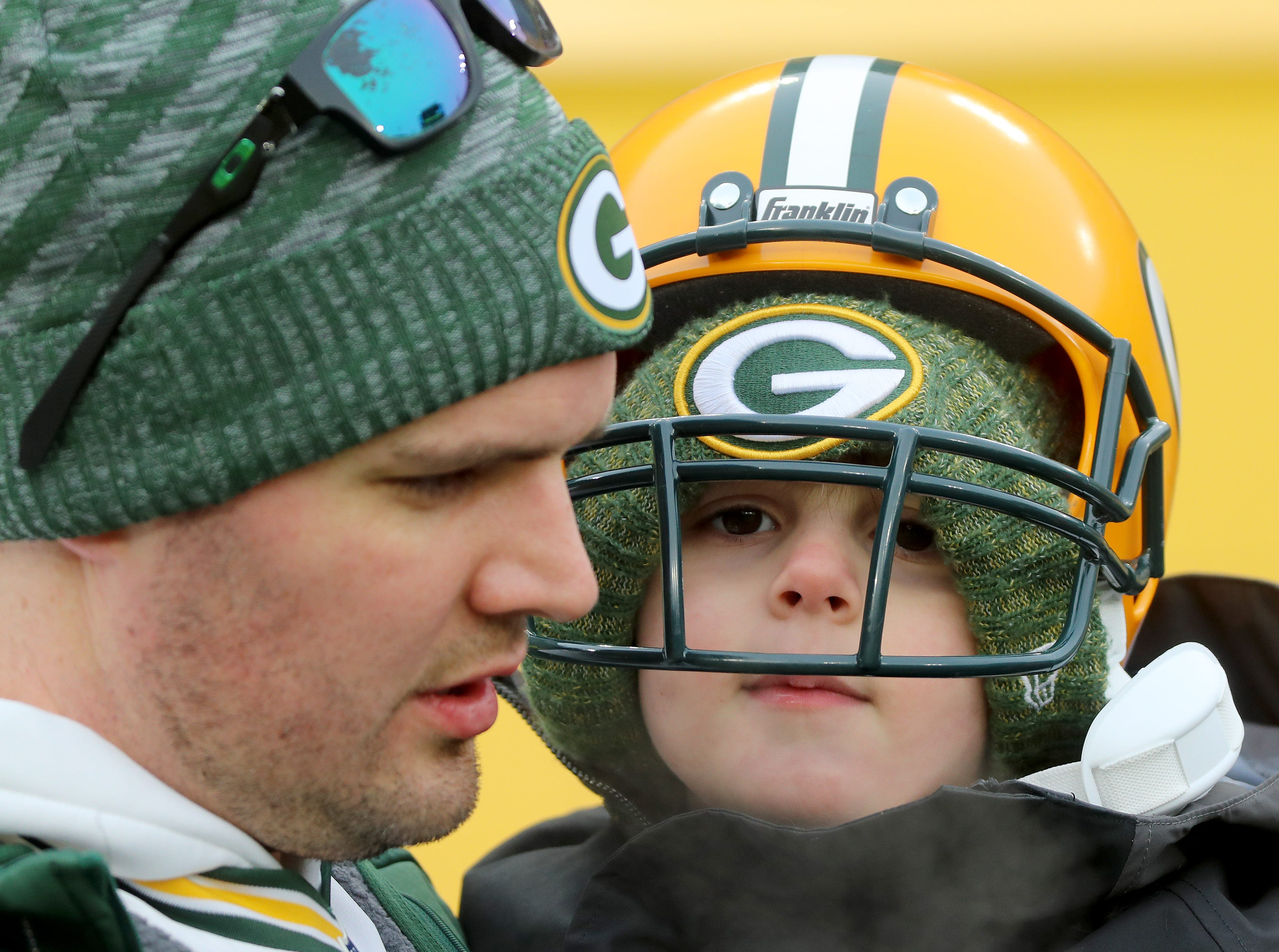 Fan Lucas Sabin is bundled up against the cold with dad Scott Sabin before the game against the Detroit Lions at Lambeau Field Sunday, December 30, 2018 in Green Bay, Wis.