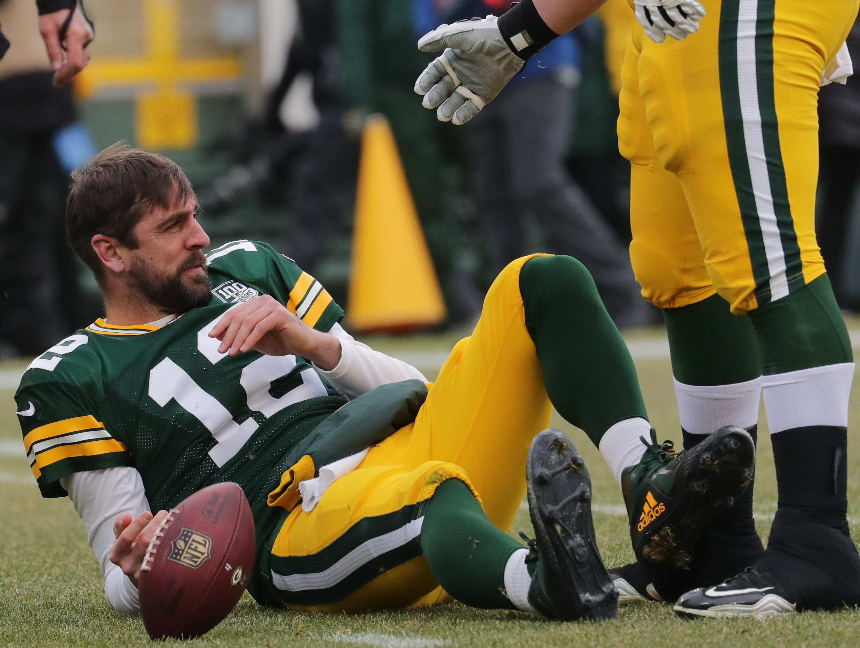 Green Bay Packers quarterback Aaron Rodgers (12) gets up after being sacked during the first quarter of their game Sunday, December 30, 2018 at Lambeau Field in Green Bay, Wis. The Detroit Lions beat the Green Bay Packers 31-0.  MARK HOFFMAN/MILWAUKEE JOURNAL SENTINEL