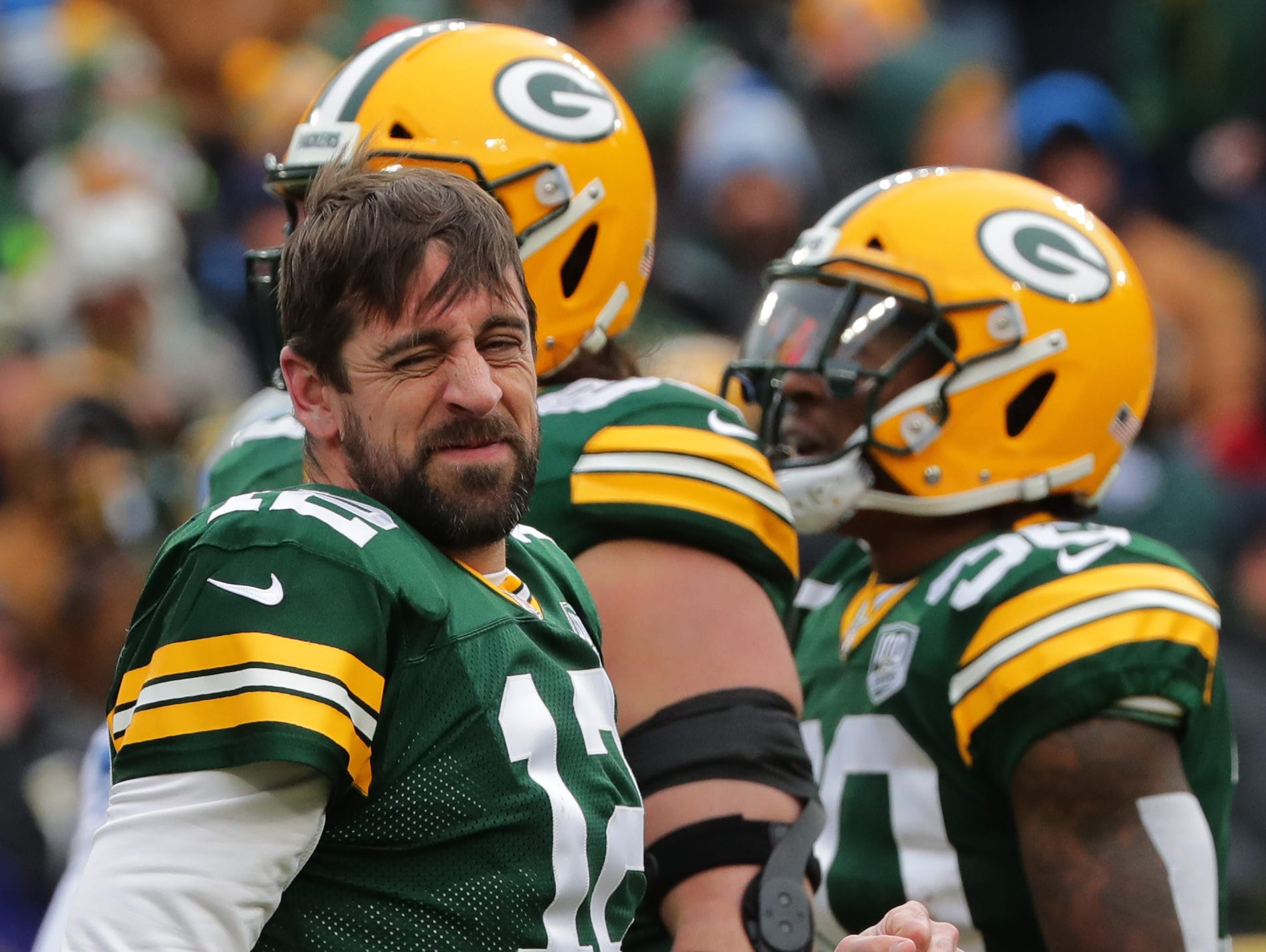 Green Bay Packers quarterback Aaron Rodgers (12) winces after being sacked during the first quarter of their game Sunday, December 30, 2018 at Lambeau Field in Green Bay, Wis. The Detroit Lions beat the Green Bay Packers 31-0.  MARK HOFFMAN/MILWAUKEE JOURNAL SENTINEL