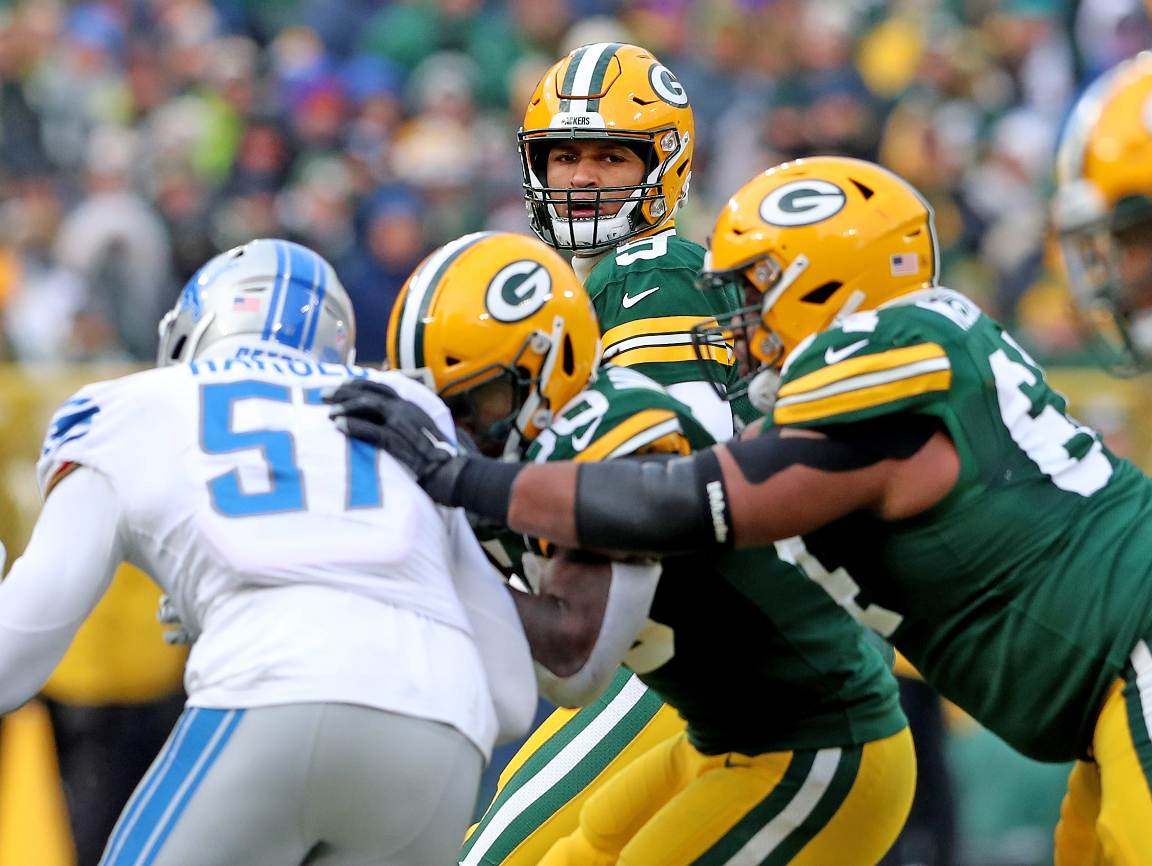 Green Bay Packers quarterback DeShone Kizer (9) looks for an open receiver against the Detroit Lions at Lambeau Field Sunday, December 30, 2018 in Green Bay, Wis.
