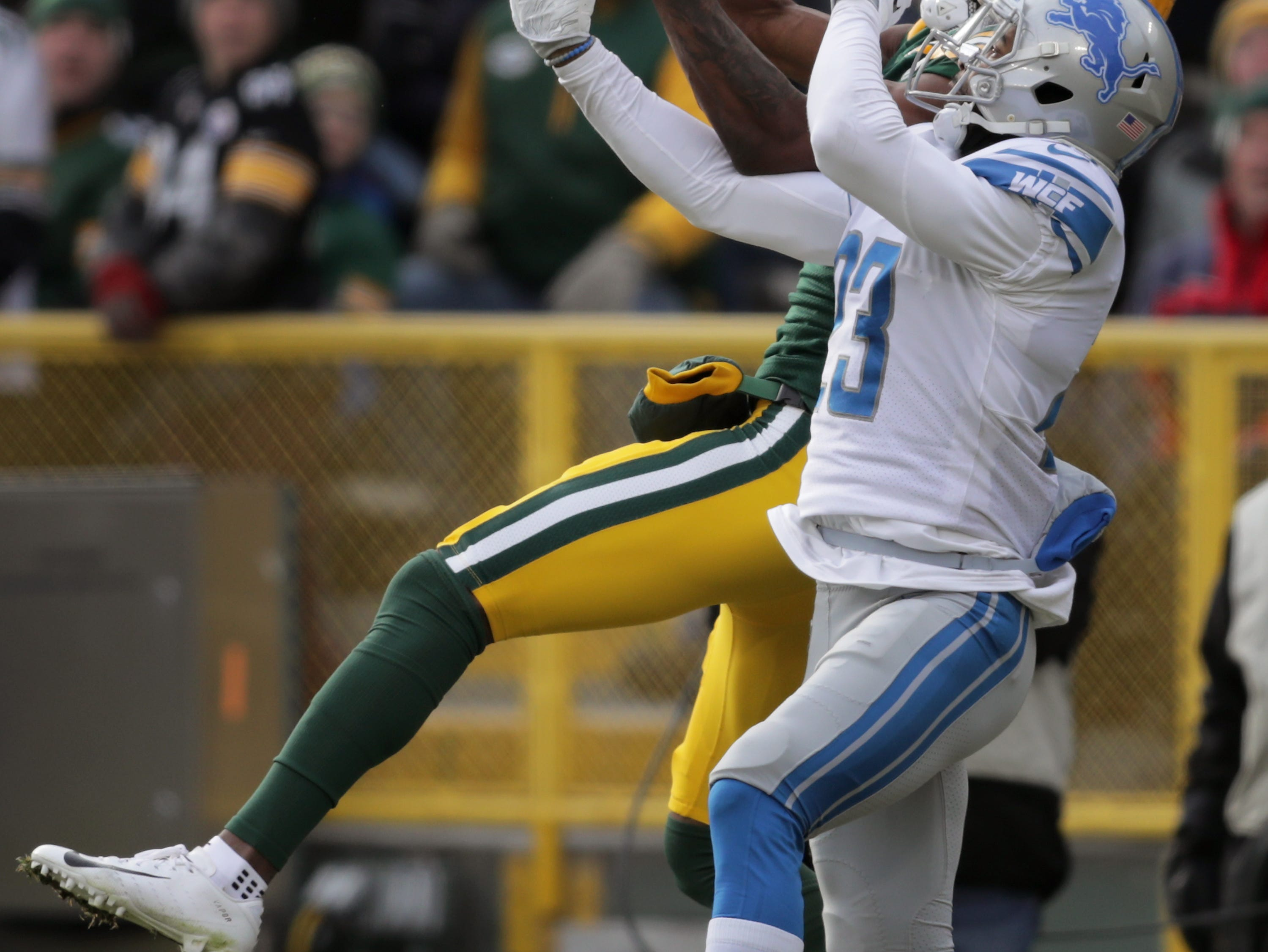 Green Bay Packers wide receiver Marquez Valdes-Scantling battles for na second half pass against Detroit Lions cornerback Darius Slay during their football game on Sunday, December 30, 2018, at Lambeau Field in Green Bay, Wis.Detroit defeated Green Bay 31 to 0. Wm. Glasheen/USA TODAY NETWORK-Wisconsin.