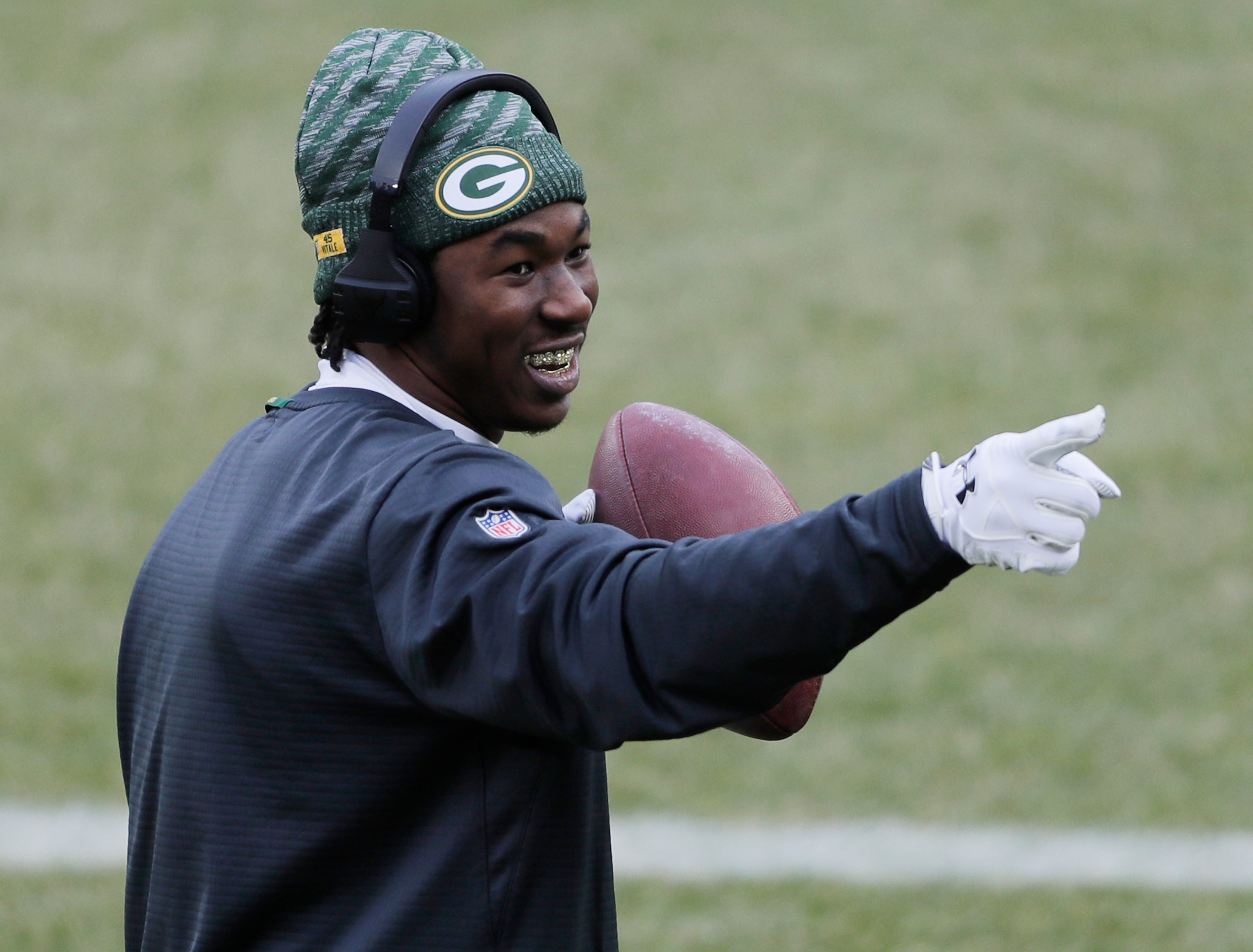 Green Bay Packers running back Jamaal Williams (30) plays catch with fans before kickoff against the Detroit Lions at Lambeau Field on Sunday, December 30, 2018 in Green Bay, Wis.