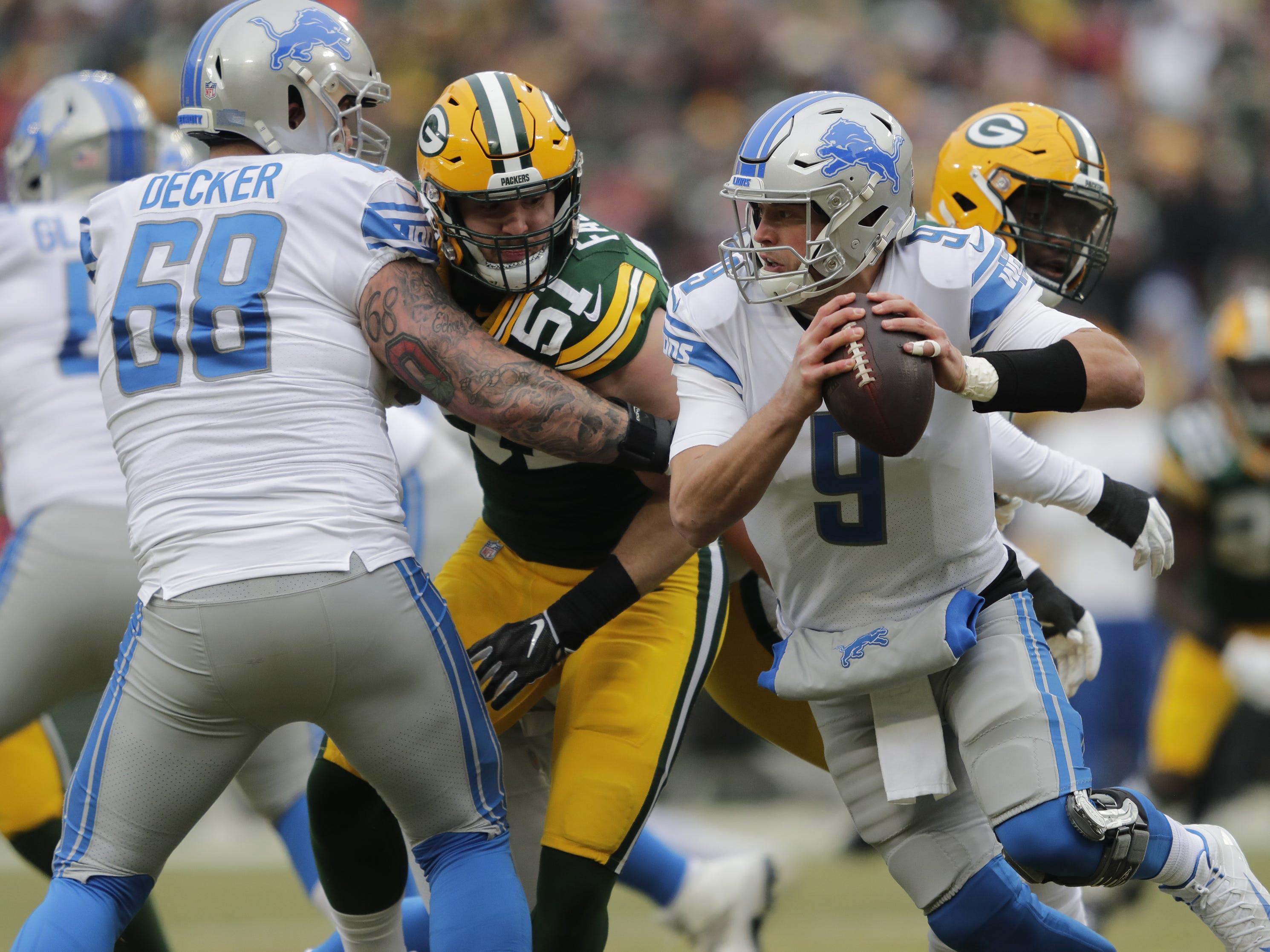 Detroit Lions quarterback Matthew Stafford (9) scrambles away from Green Bay Packers linebacker Kyler Fackrell (51) in the first half Sunday, December 30, 2018, at Lambeau Field in Green Bay, Wis.  Dan Powers/USA TODAY NETWORK-Wisconsin