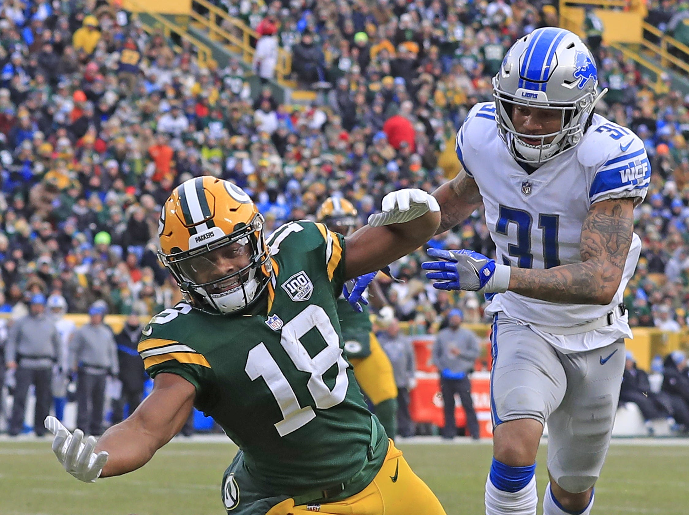 Green Bay Packers wide receiver Randall Cobb (18) can't hold on to a pass against Detroit Lions cornerback Teez Tabor (31) in the fourth quarter at Lambeau Field on Sunday, December 30, 2018 in Green Bay, Wis. Adam Wesley/USA TODAY NETWORK-Wis