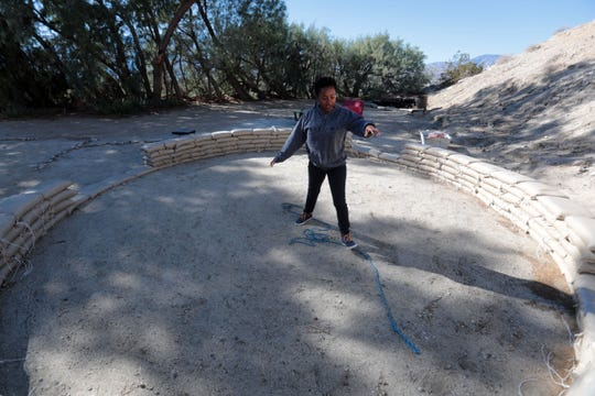 Gye Nyame Maat shows off the prototype house she is developing for disaster victims in Haiti on Saturday, December 29, 2018 in Desert Hot Springs. Her project fits into the seven core principles of Kwanzaa.