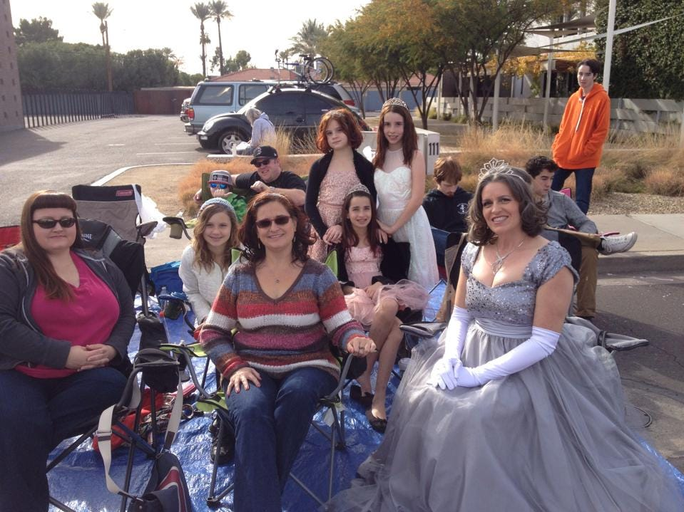 Karen Bayless Feldman with friends and family on her regular spot along the Fiesta Bowl parade route in 2013.