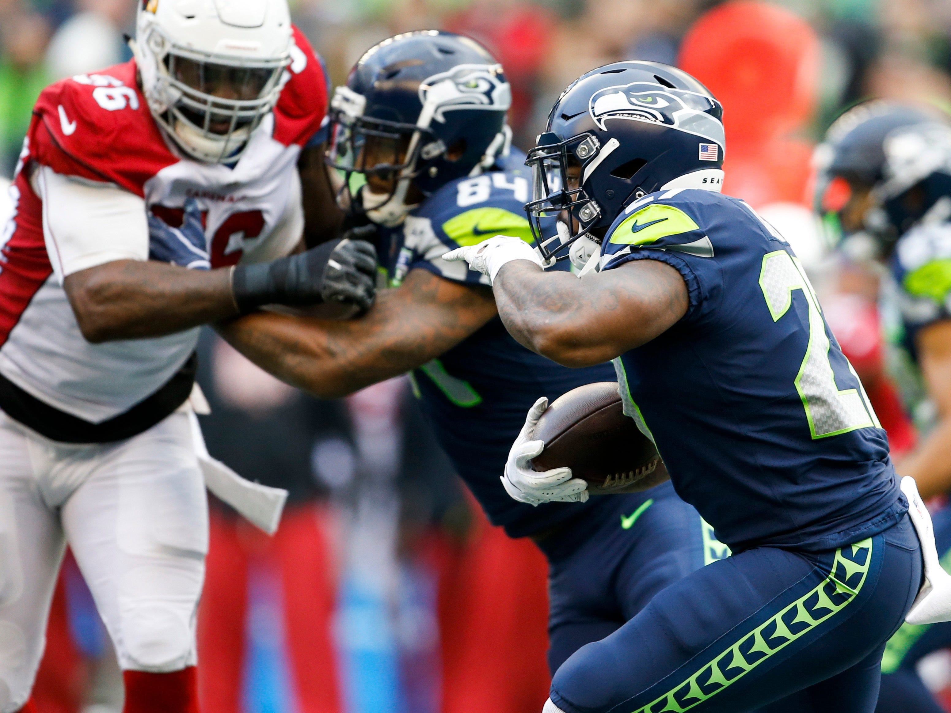 Dec 30, 2018; Seattle, WA, USA; Seattle Seahawks running back Mike Davis (27) rushes against the Arizona Cardinals during the first quarter at CenturyLink Field. Mandatory Credit: Joe Nicholson-USA TODAY Sports