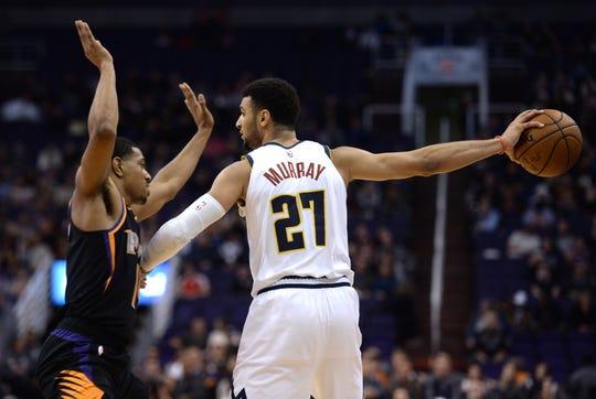 Dec 29, 2018; Phoenix, AZ, USA; Phoenix Suns guard De'Anthony Melton (14) guards Denver Nuggets guard Jamal Murray (27) during the second half at Talking Stick Resort Arena.