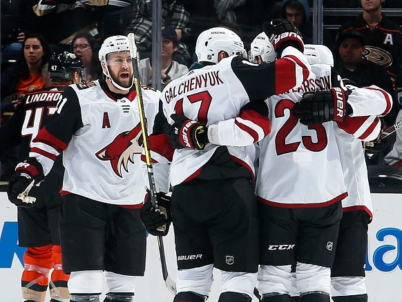 ANAHEIM, CA - DECEMBER 29:  Derek Stepan #21, Alex Galchenyuk #17, and Oliver Ekman-Larsson #23 of the Arizona Coyotes celebrate a first period goal during the game against the Anaheim Ducks on December 29, 2018 at Honda Center in Anaheim, California. (Photo by Debora Robinson/NHLI via Getty Images)