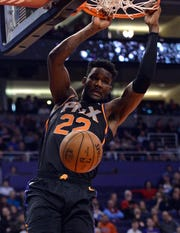 Dec 29, 2018; Phoenix, AZ, USA; Phoenix Suns center Deandre Ayton (22) dunks against the Denver Nuggets during the first half at Talking Stick Resort Arena.