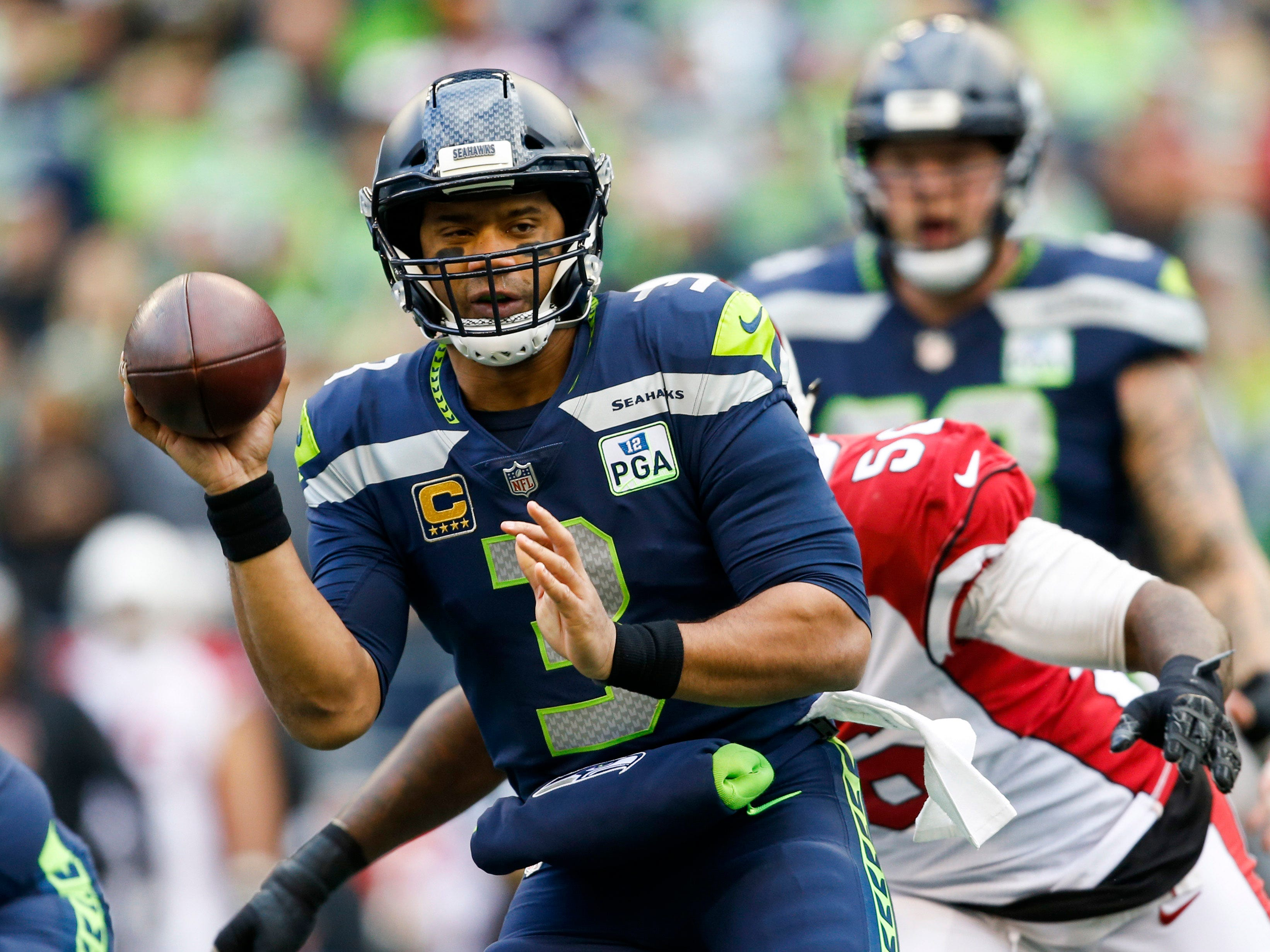 Dec 30, 2018; Seattle, WA, USA; Seattle Seahawks quarterback Russell Wilson (3) throws a lateral pass against the Arizona Cardinals during the first quarter at CenturyLink Field. Mandatory Credit: Joe Nicholson-USA TODAY Sports