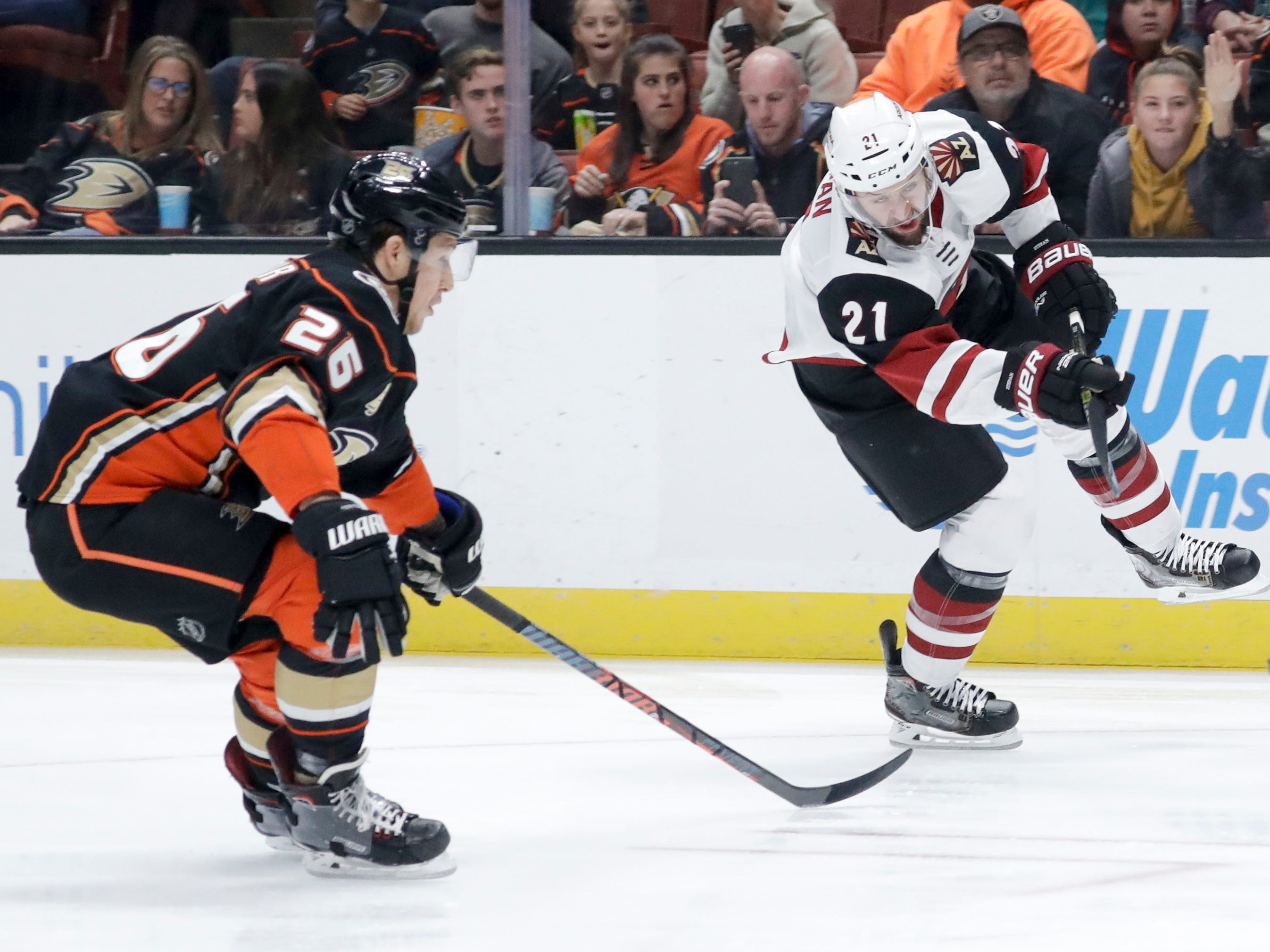Arizona Coyotes center Derek Stepan, right, shoots past Anaheim Ducks defenseman Brandon Montour during the first period of an NHL hockey game in Anaheim, Calif., Saturday, Dec. 29, 2018. (AP Photo/Chris Carlson)