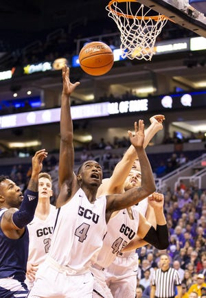 Forward Oscar Frayer (4) of the Grand Canyon Antelopes reaches for a rebound against Nevada Wolf Pack during the 2018 Jerry Colangelo Classic at Talking Stick Resort Arena on Sunday, December 9, 2018 in Phoenix, Arizona.