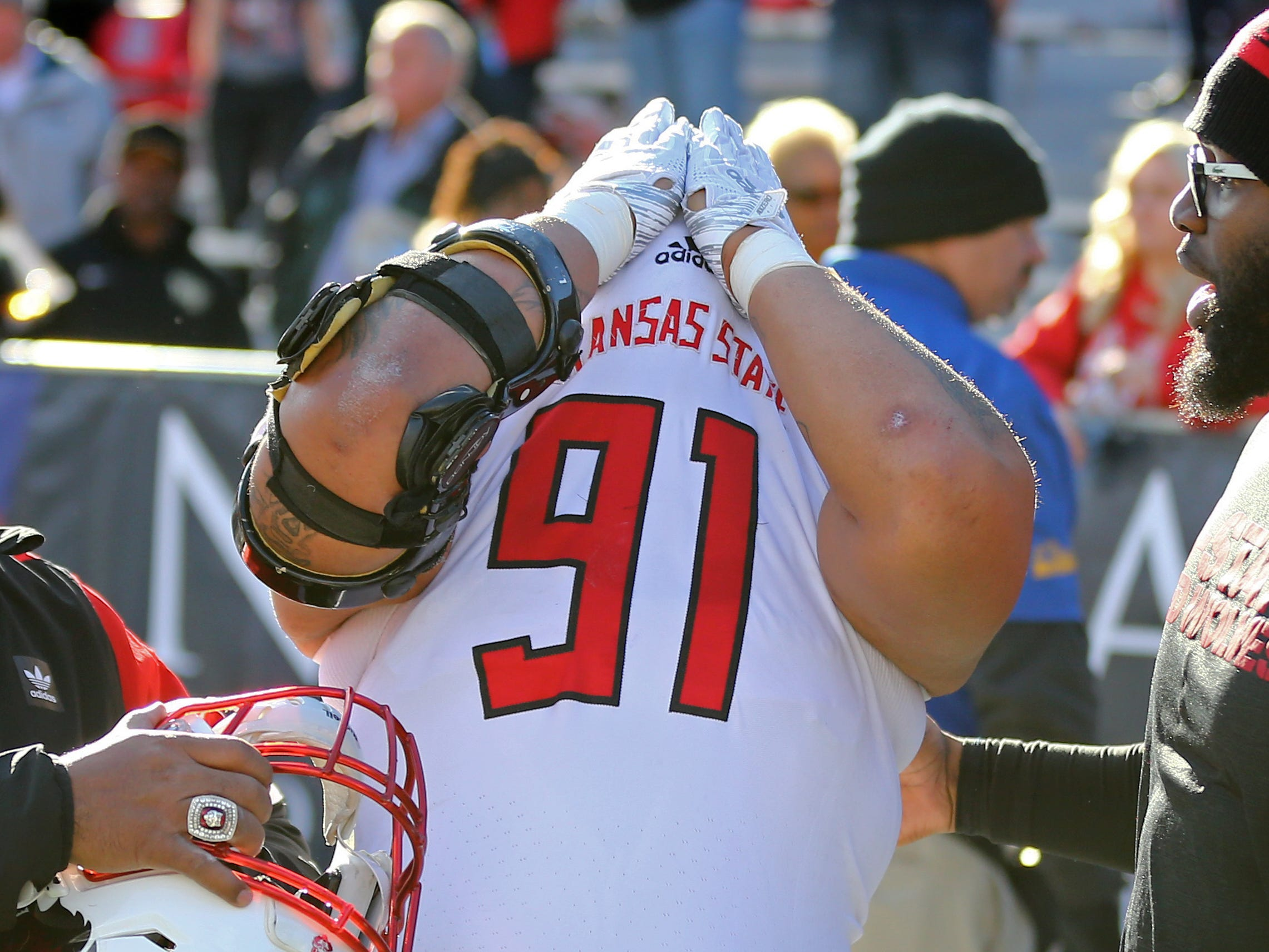 Dec 29, 2018; Tucson, AZ, USA; Arkansas State Red Wolves defensive lineman Donovan Ransom (91) cries under his jersey after losing in overtime to the Nevada Wolf Pack in the 2018 Arizona Bowl at Arizona Stadium.