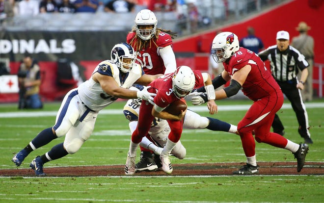 Arizona Cardinals quarterback Josh Rosen is sacked by the Los Angeles Rams in the second half on Dec. 23 at State Farm Stadium.
