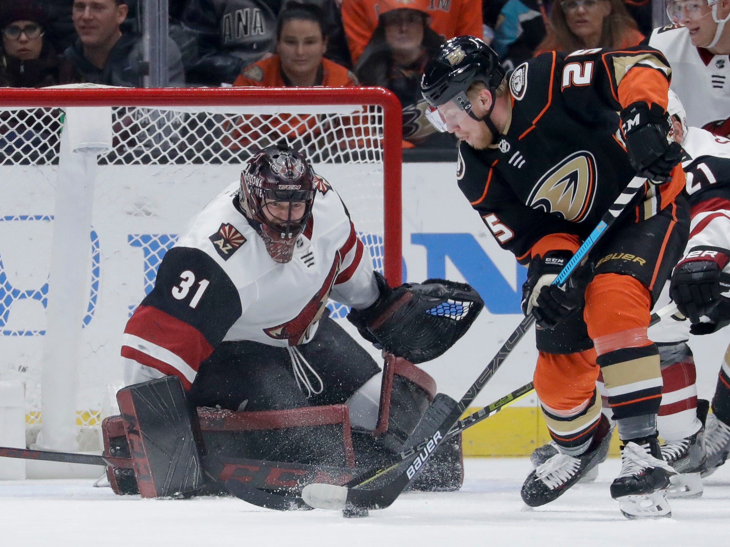 Arizona Coyotes goaltender Adin Hill, left, blocks a shot by Anaheim Ducks right wing Ondrej Kase during the first period of an NHL hockey game in Anaheim, Calif., Saturday, Dec. 29, 2018. (AP Photo/Chris Carlson)