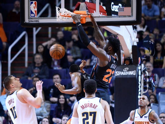 Dec 29, 2018; Phoenix, AZ, USA; Phoenix Suns center Deandre Ayton (22) dunks against the Denver Nuggets during the second half at Talking Stick Resort Arena.