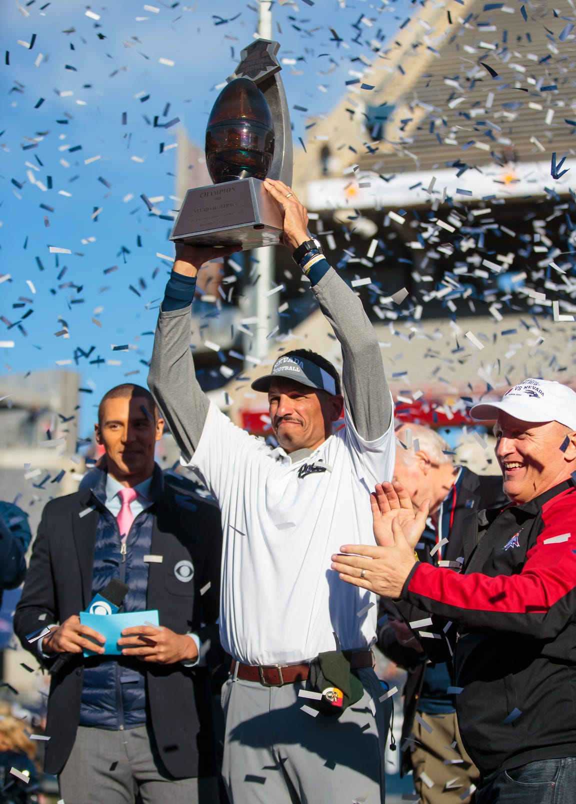 Dec 29, 2018: Nevada Wolf Pack head coach Jay Norvell celebrates with the trophy after defeating the Arkansas State Red Wolves in overtime of the 2018 Arizona Bowl at Arizona Stadium.