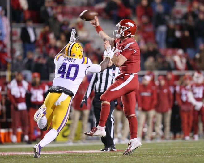 Nov 10, 2018: Arkansas Razorbacks quarterback Ty Storey (4) passes as LSU Tigers linebacker Devin White (40) defends at Donald W. Reynolds Razorback Stadium. LSU won 24-17.