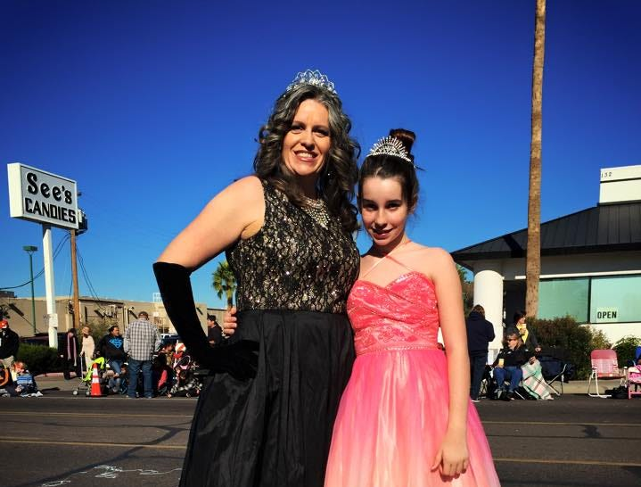 Karen Bayless Feldman with daughter Abby in their usual attire and usual spot at the Fiesta Bowl Parade in 2014.