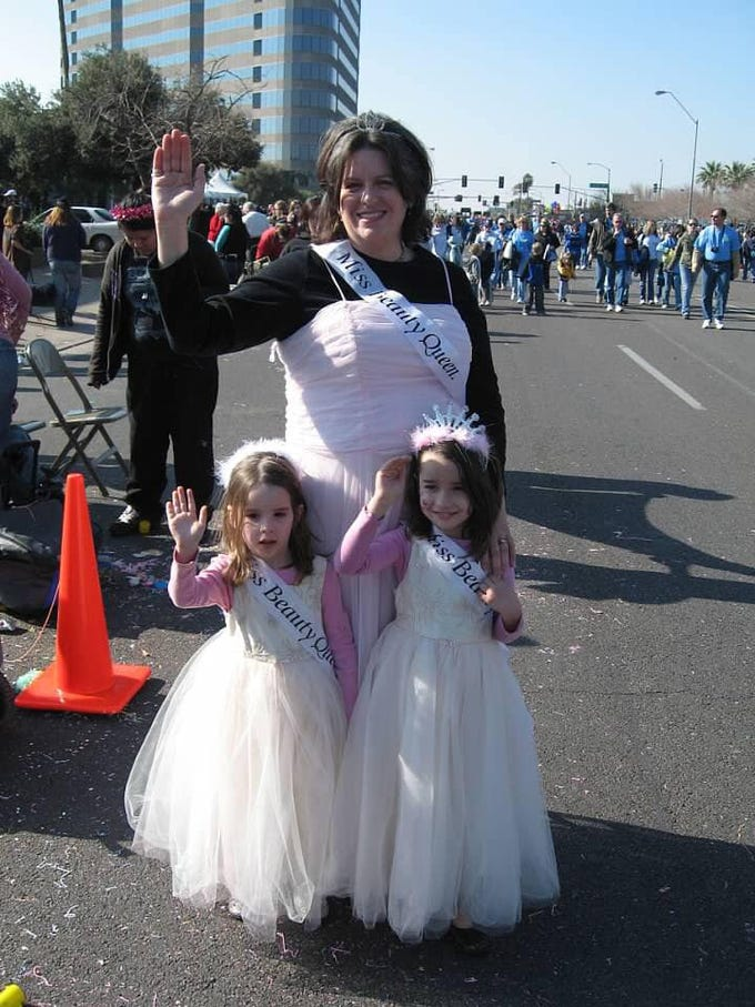 Karen Bayless Feldman with daughters Abby and Sophie at the Fiesta Bowl Parade in 2006.