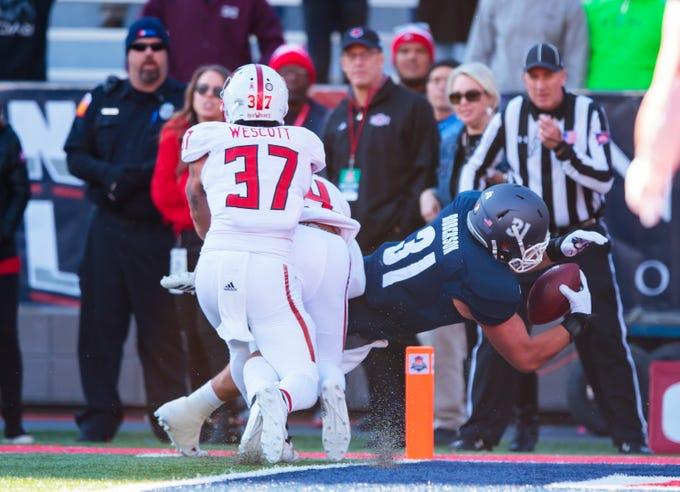 Dec 29, 2018; Tucson, AZ, USA; Nevada Wolf Pack tight end Reagan Roberson (31) dives into the end zone to score the winning touchdown in overtime against the Arkansas State Red Wolves in the 2018 Arizona Bowl at Arizona Stadium.