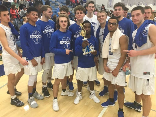 The Cedar Crest boys pose with their holiday tournament championship trophy after outlasting Lebanon in overtime, 58-52, in the championship game at the Falcon Cage back in late Decmber. The Falcons are closing in on another championship, the L-L Section 1 title.