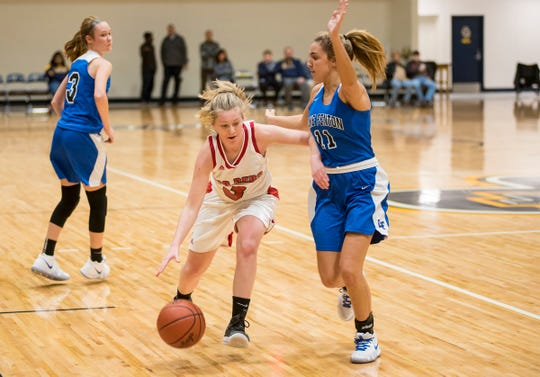 Lake Fenton High School forward Leigha Crawford (11) defends against Port Huron High School guard Madison Landschoot during their SC4 Holiday Basketball Showcase game Saturday, Dec. 29, 2018 at the SC4 Fieldhouse.