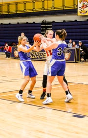 Port Huron High School forward Emma Trombly (center) fights for the ball with Lake Fenton High School forwards Leigha Crawford (left) and Christina Lamb during their SC4 Holiday Basketball Showcase game Saturday, Dec. 29, 2018 at the SC4 Fieldhouse.