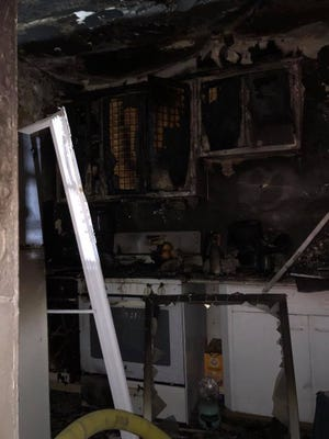 A photo shows damage to a kitchen by a fire in the city of Poughkeepsie on Saturday night.