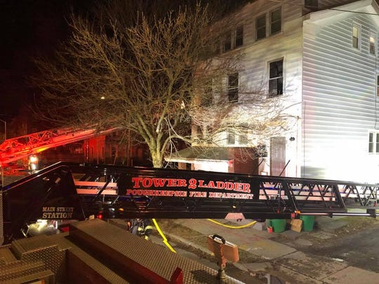 Firefighters respond to a fire in an apartment on Academy Street in the city of Poughkeepsie on Saturday night.