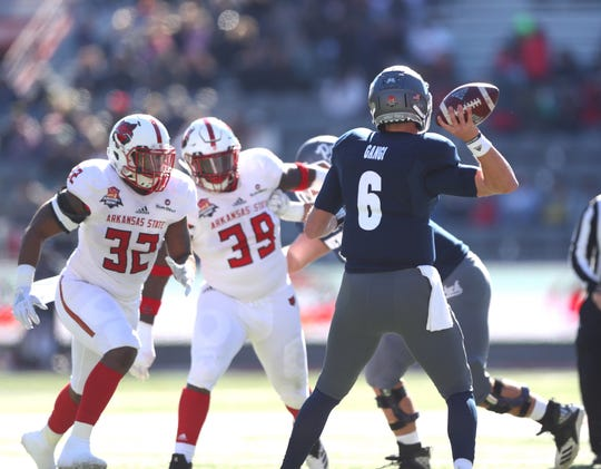 Nevada quarterback Ty Gangi throws against Arkansas State in last season's Arizona Bowl. At 5-4, this year's Wolf Pack team needs one more win to become bowl-eligible.
