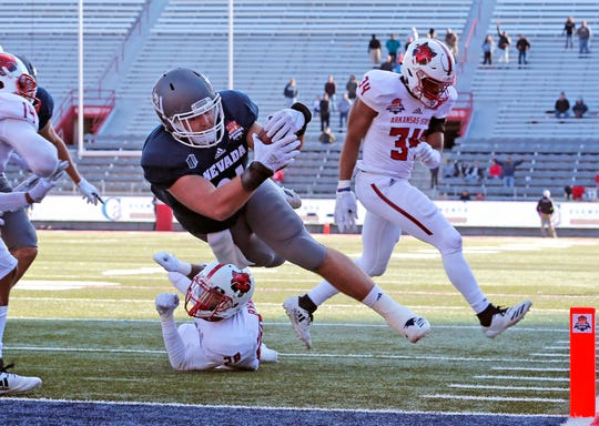 Nevada tight end Reagan Roberson scores the winning touchdown in overtime against Arkansas State at last season's Arizona Bowl.