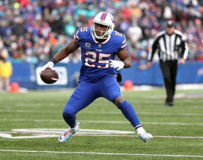 Bills running back LeSean McCoy looks for yardage against the Dolphins. At age 31, McCoy enters the preseason as the Buffalo Bills No. 1 running back