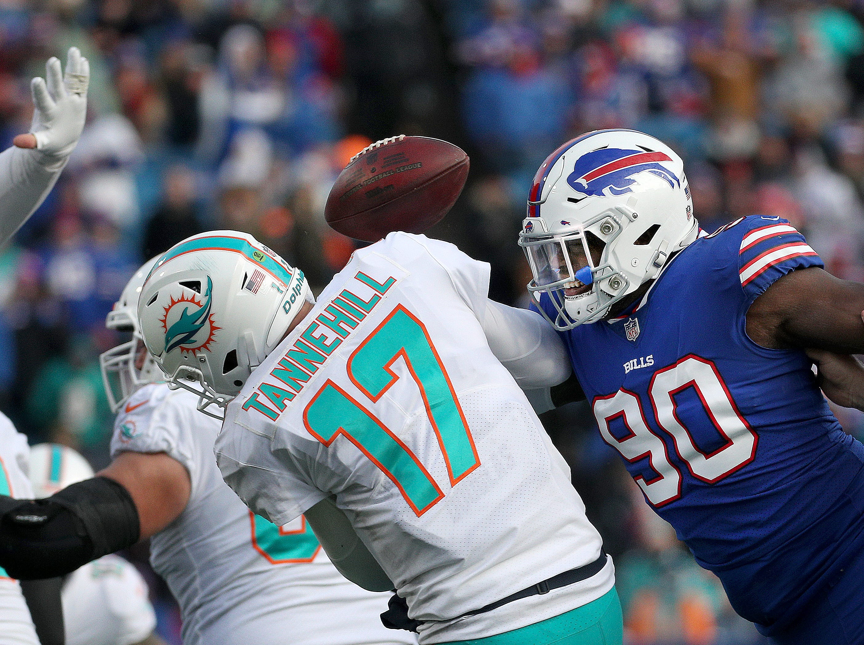 Bills defensive end Shaq Lawson forces a fumble as he sacks Miami quarterback Ryan Tannehill.  The Bills beat the Dolphins 42-17.