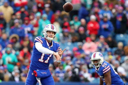 Dec 30, 2018; Orchard Park, NY, USA; Buffalo Bills quarterback Josh Allen (17) passes the ball against the Miami Dolphins during the first quarter at New Era Field. Mandatory Credit: Rich Barnes-USA TODAY Sports