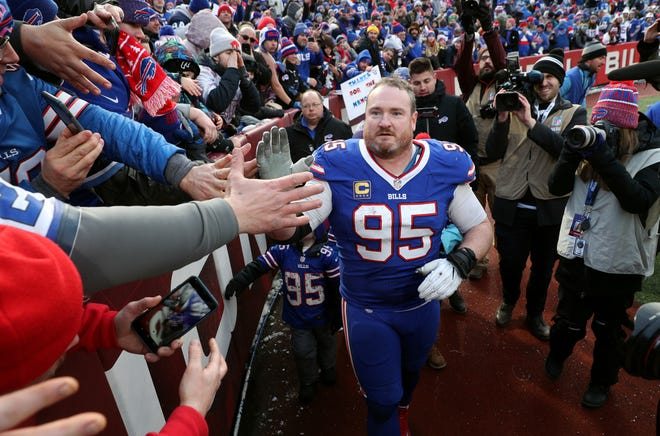 Bills defensive tackle Kyle Williams circles the field to thank fans after his last game.  Williams is retiring after 13 years with the Bills.  The Bills beat the Dolphins 42-17.